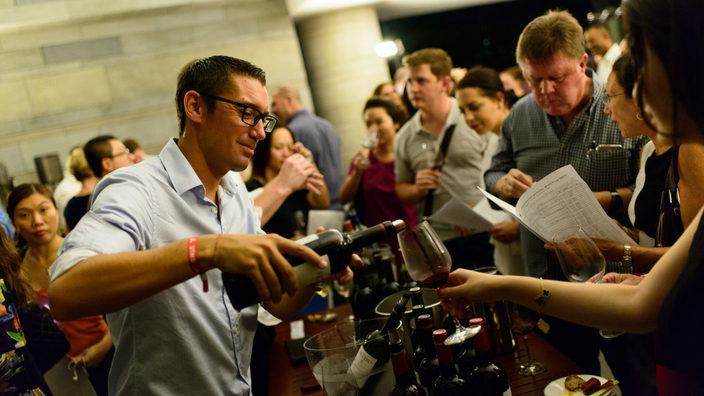 Man pouring wine at Kedington Wine Fair