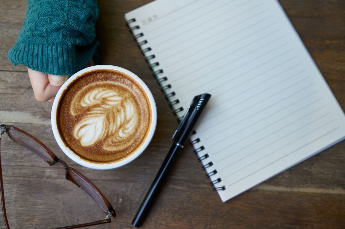 notepad and cofffee